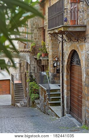 Little courtyard with flowers in Orvieto, Italy, Toscana