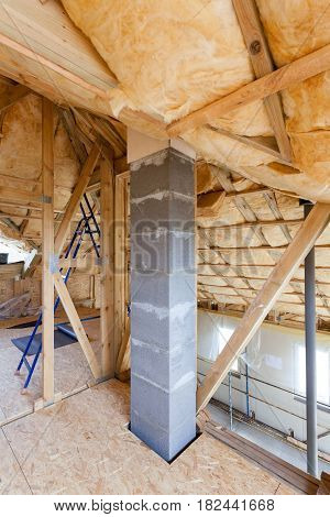 Iinsulation of attic with fiberglass cold barrier and insulation material