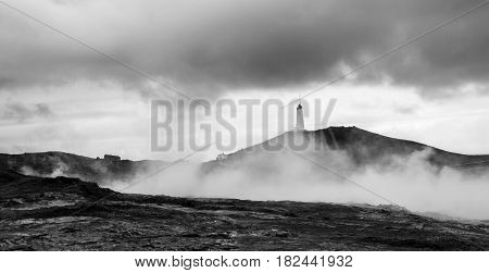 Lighthouse in the Geothermal field of Gunnuhve Iceland. Gunnuhver is a geothermic area in Iceland the ground is boiling hot and there are vents and fumaroles with hot sulfuric steam.