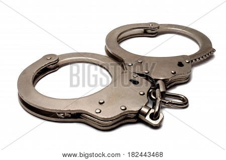 police handcuffs lying on a white background