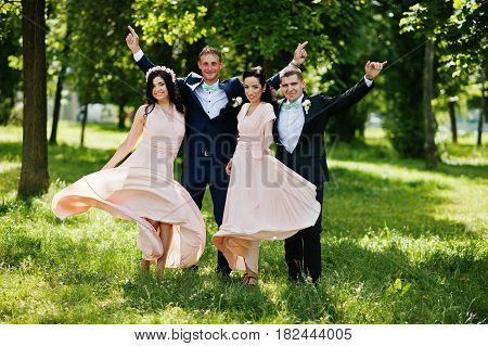 Best Man's With Bridesmaids On Wedding At Park.
