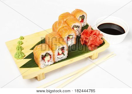 Roll with salmon, cucumber, flying fish roe and Philadelphia cheese isolated on a white background