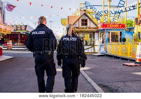 Frankfurt am Main, Germany - April 19, 2017: Police officers in dippemess in  Frankfurt am Main, Germany.