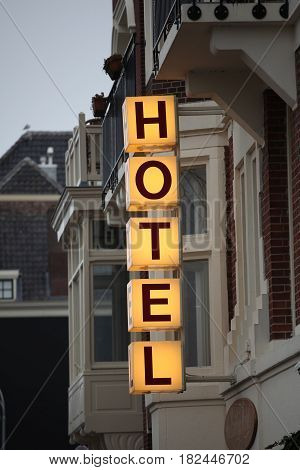 Hotel sign posted outside in Amsterdam, Netherlands.