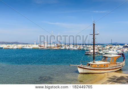 The picturesque Harbor with fishing boats in a sunny summer day, Kefalos village, Kos island, Dodecanese, Greece