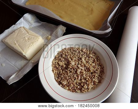 Crushed nuts, butter and dough , baking cakes