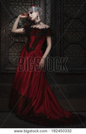 Fairy woman in a red gothic dress.