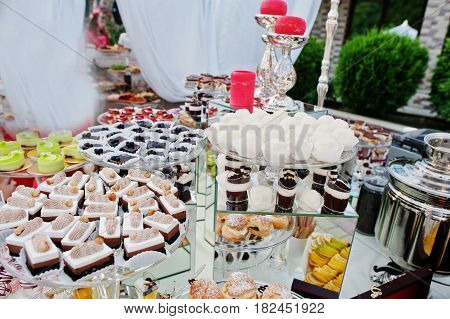 Wedding Catering Table With Different Sweets And Cakes.