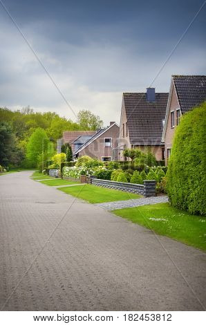 Photo of Street With Houses and Gardens