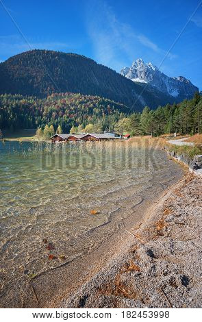Swimming Lake Lautersee With Boathouses In Idyllic Bavarian Landscape
