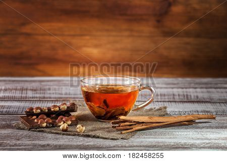 orange-pekoe chocolate and thin captain on a wooden table