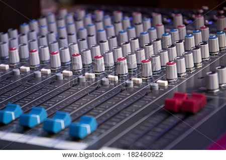 Sound mixer. Professional audio mixing console with lights buttons faders and sliders.