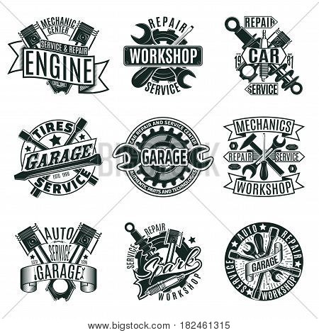 Monochrome car repair service logos set with mechanic tools and equipment in vintage style isolated vector illustration