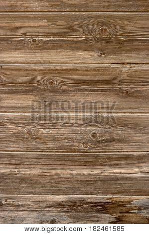 Old wood planks background. Vintage colored abandoned fence planks vertical background.