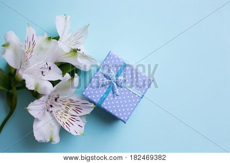 Blue Gift Box With Alstroemeria Flowers On Light Blue Background