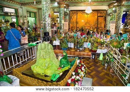 YANGON, MYANMAR - MARCH 3; 2017: Interior of Botataung Pagoda (literally: 1000 military officers); a famous complex in Yangon; Myanmar. It was completely destroyed during World War II