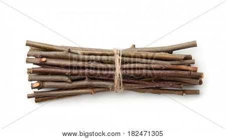 Bunch of wooden twigs isolated on white