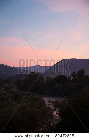 River in the Ukrainian Carpathian Mountains at twilight.