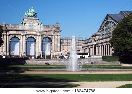 BRUSSELS BELGIUM-OCTOBER 1: The Triumphal Arch and Royal Military Museum are seen in Parc du Cinquantenaire (Jubilee Park) with tourists in Brussels Belgium on October 1 2015.