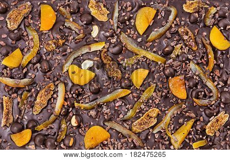Chocolate bar with dried fruit and nuts could be used as background