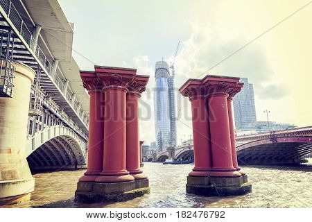 Red Pillars For The Construction Of A Bridge