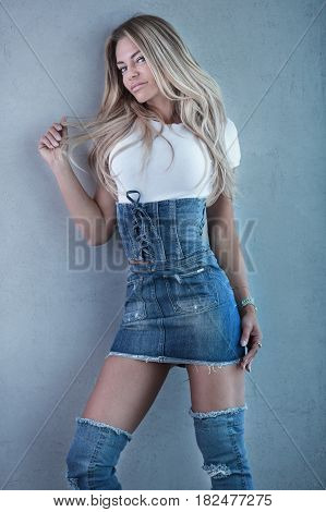 Blonde Woman Posing In Jeans.
