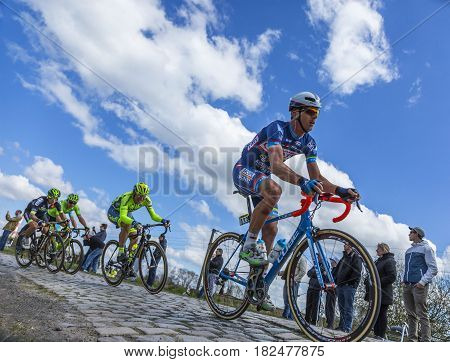 Hornaing France - April 102016: The Belgian cyclist Dimitri Claeys of Wanty-Groupe Gobert Team riding in the peloton on a paved road in Hornaing France during Paris Roubaix on 10 April 2016.