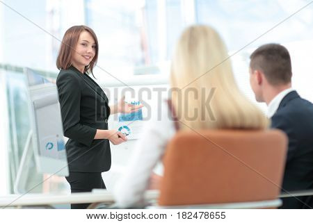Attractive woman making a business presentation to a group