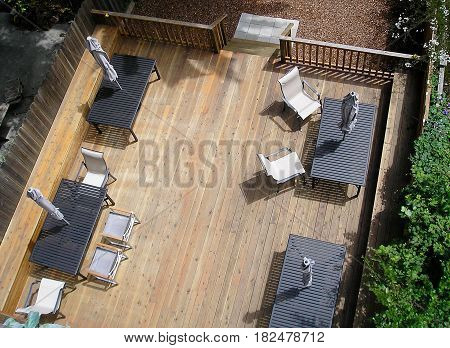 Luxury patio deck seen from above ground.