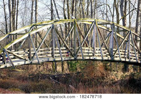 Old wooden bridge for crossing displayed outdoors.