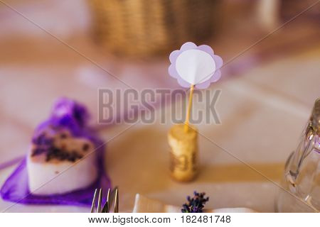 Blank bright place card on wood table with hearts and ribbon