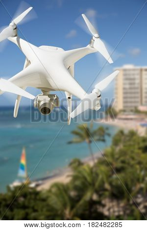 Unmanned Aircraft System (UAV) Quadcopter Drone In The Air Over Waikiki Beach In Hawaii.