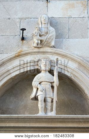 KORCULA, CROATIA - NOVEMBER 09: Statue of St. Roch on the St Mark s Cathedral in the historic city Korcula at the island Korcula in Croatia on November 09, 2016.