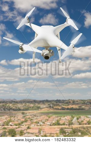 Unmanned Aircraft System (UAV) Quadcopter Drone In The Air Over Rural Neighborhood Houses.