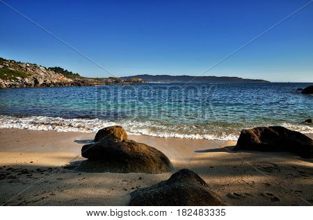 Ocean coast in the north west of Spain, Galicia region, Udra Cape beaches with tropical color
