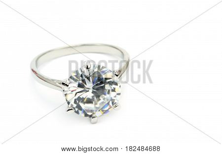Diamond solitaire ring isolated on white black background