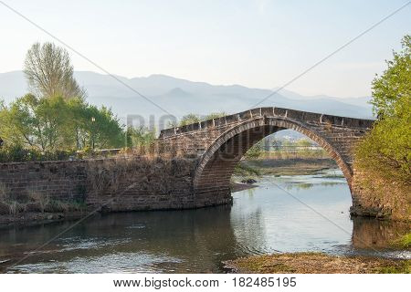 Yunnan, China - Mar 21 2015: Yujin Bridge At Shaxi Ancient Village. A Famous Ancient Village Of Jian