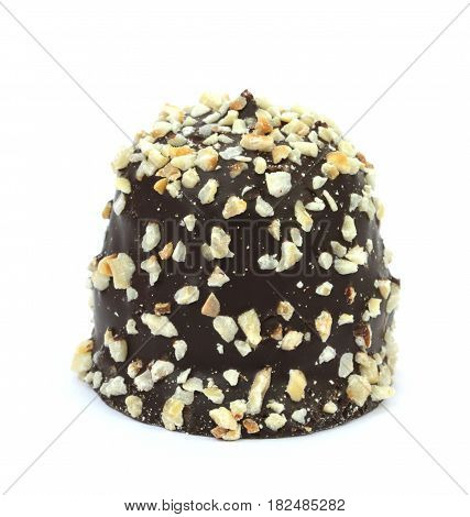 Chocolate coated cream puff with hazelnuts on white background