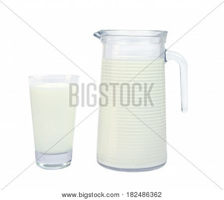 Milk in glass and carafe isolated on white background