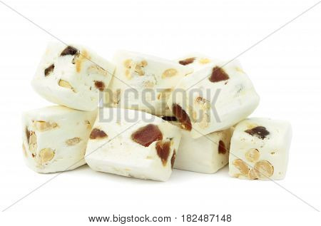 Soft nougat with peanuts and fruits isolated on a white background