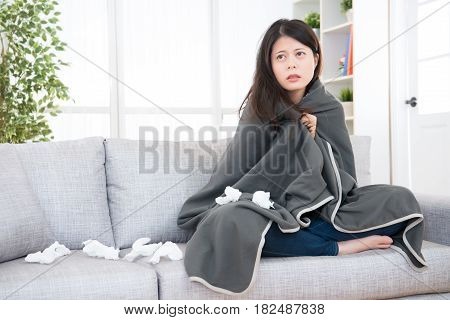 Woman Feeling Sick And Wrapped In Blanket