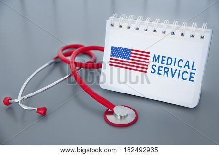 Stethoscope and notebook with text MEDICAL SERVICE and USA flag on grey background