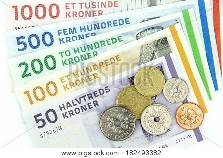 Danish kroner ( DKK ), coins and banknotes .