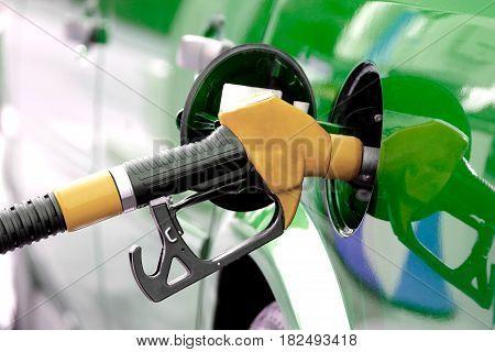 Pumping fuel , close up image .