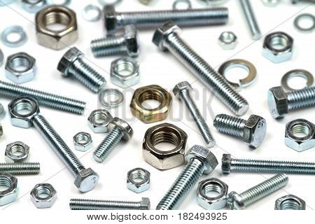 Close up various bolts, nuts, and washers on white background.