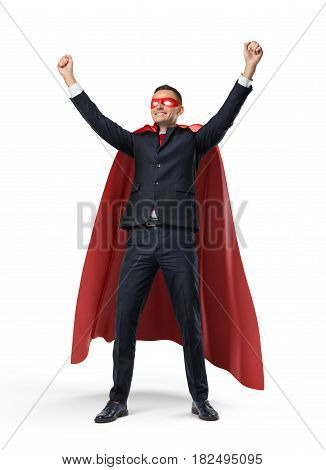 A businessman in a superhero red cape and a mask standing in front view with hands raised in victory on white background. Business and success. Luck and fortune. Lottery win.