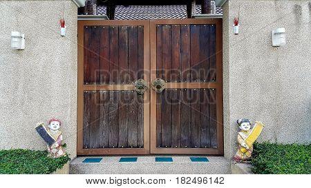 Vintage wooden door with old metal door handle knocker