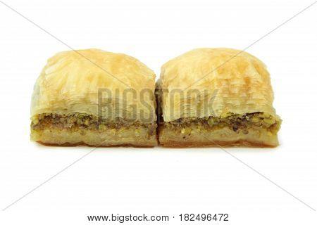 Delicious Turkish baklava isolated on white background.