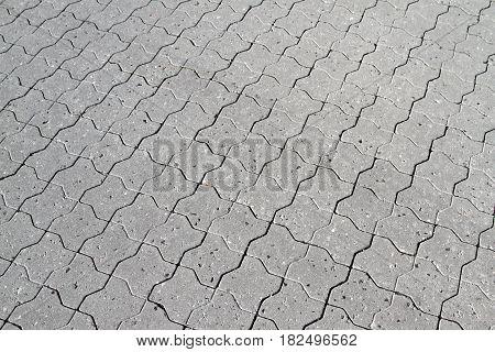 Gray pavement stones close up image .