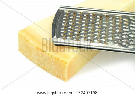 Parmesan cheese and grater on white background